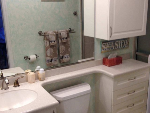 Beach themed bathroom vanity and cabinets