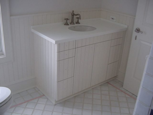 White bead board bathroom vanity