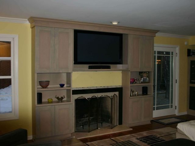 Birdseye maple wood fireplace surround with recessed panel doors