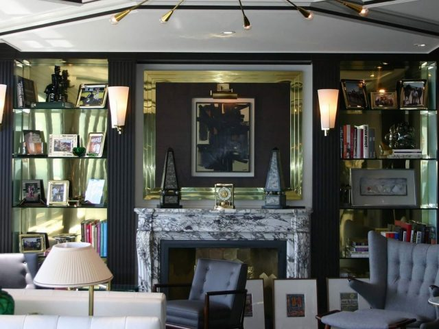 Black fireplace bookcases with brass trim