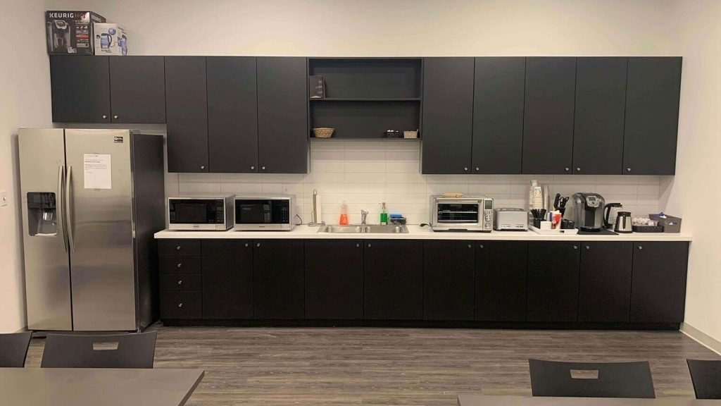 Commercial breakroom with black MDF doors