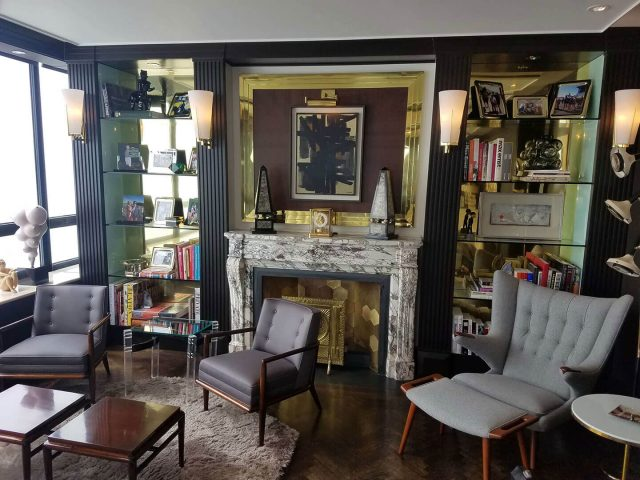 Black bookcases with brass trim