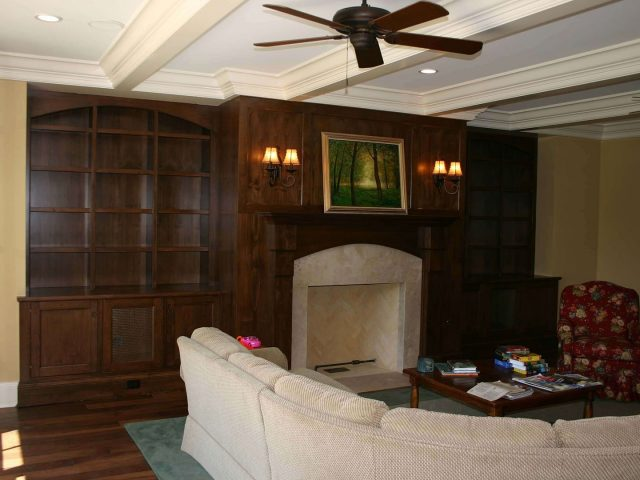 Custom fireplace surround with cherry wood bookcases