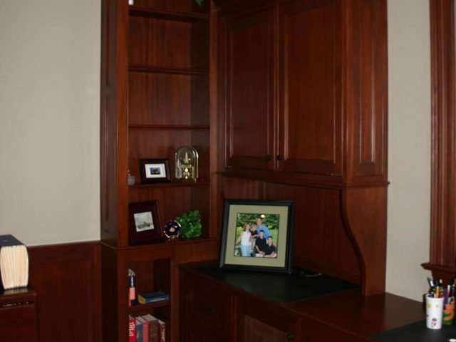 Custom cherry wood office cabinets and bookcase