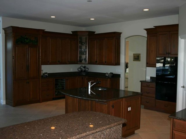 Cherry kitchen cabinets with raised panel fronts