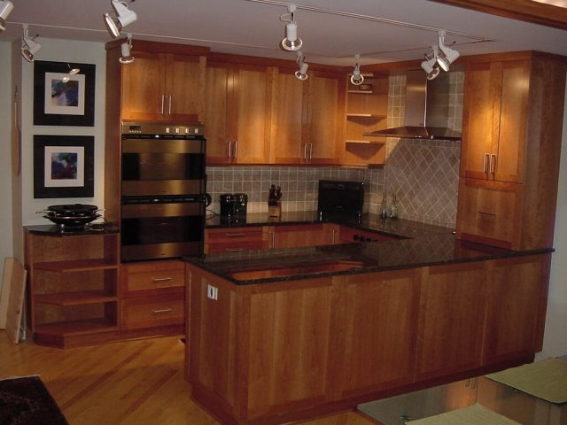 Recessed panel kitchen cabinets made from cherry wood