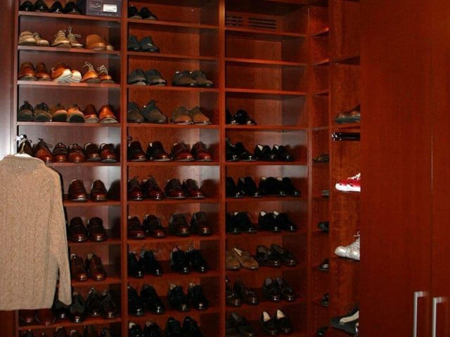 Shoe closet with cherry wood cabinetry