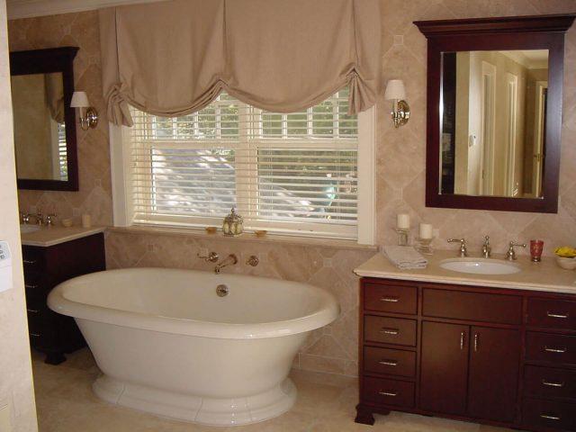 Cherry wood vanities and custom mirror frame
