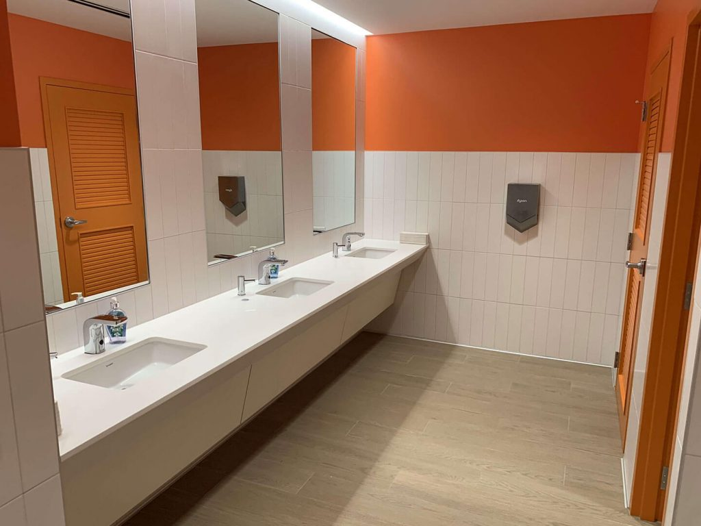 Commercial bathroom with custom white countertop