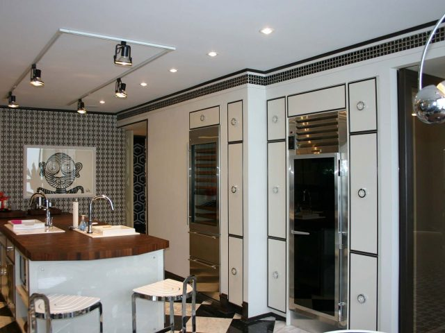 Painted white kitchen cabinet doors with black trim