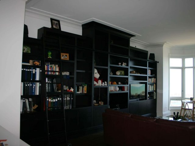 Fireplace surround with cherry bookcases
