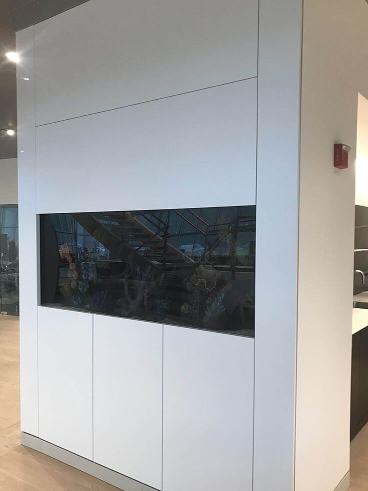 White fish tank surround for Audi dealership