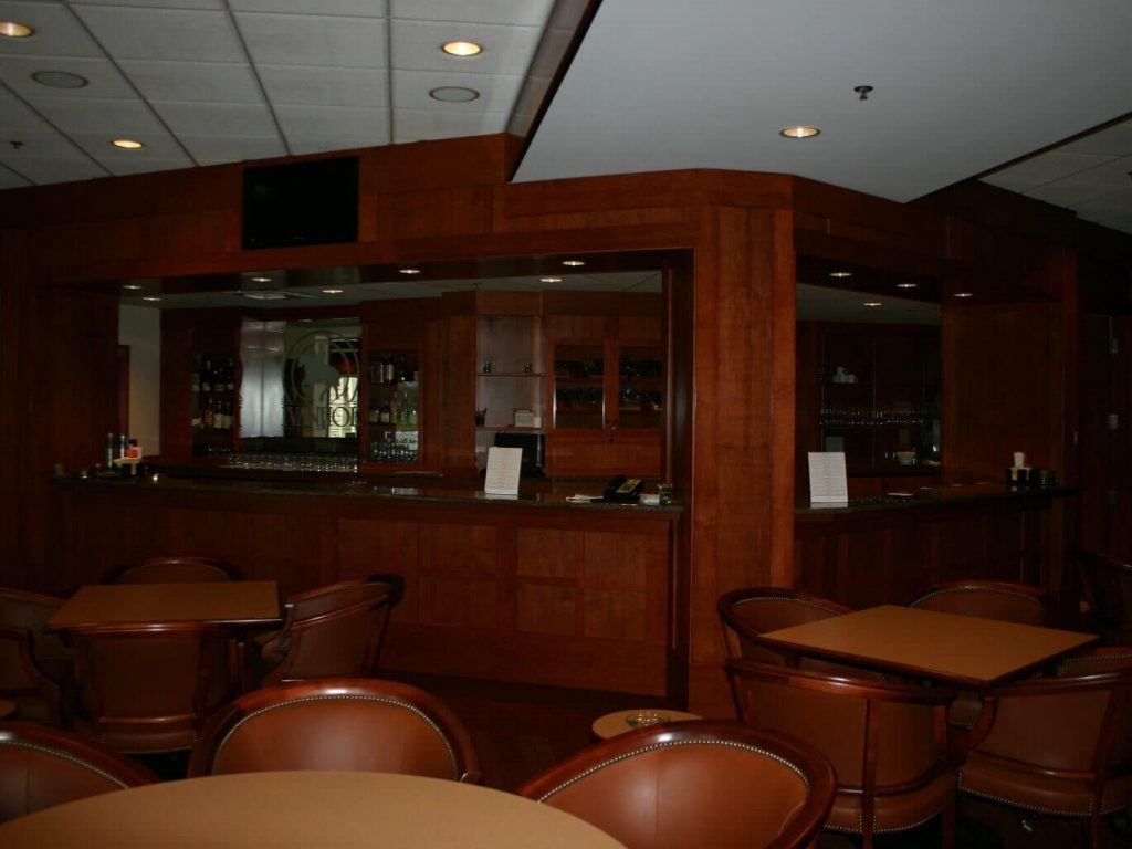 Golf club lounge with custom wood cabinetry