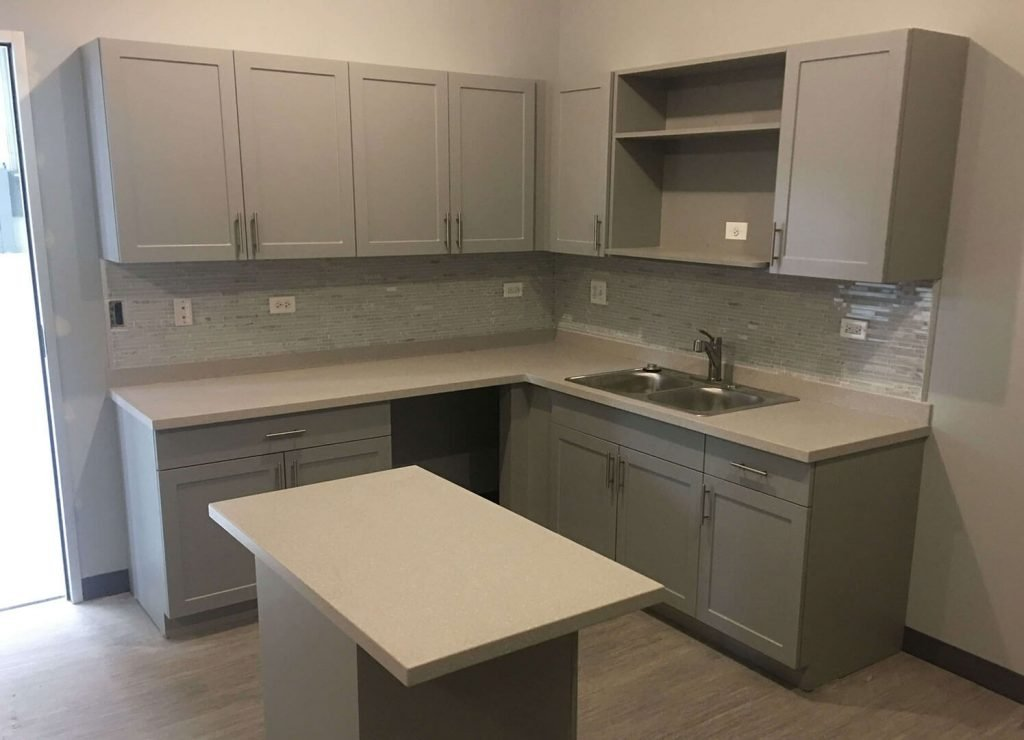 Breakroom kitchen with laminate cabinets and island