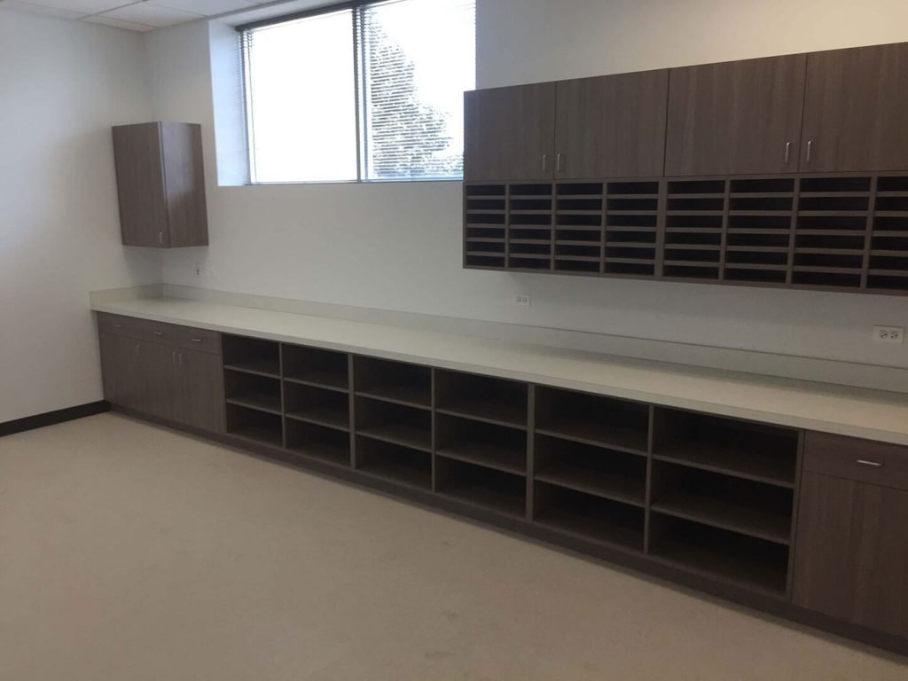Mailroom with laminate cabinets