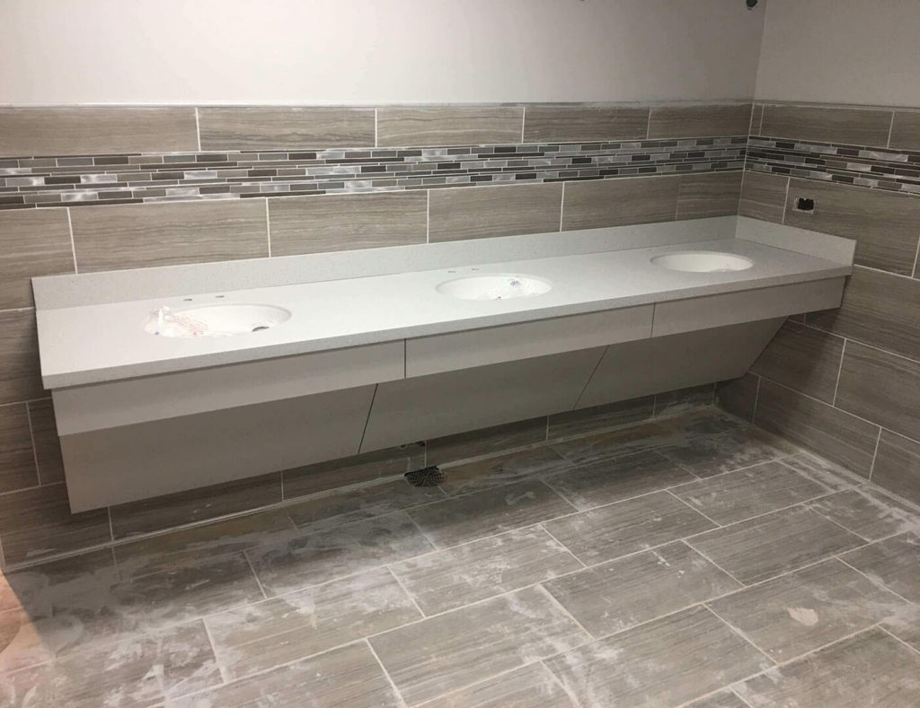 Commercial restroom with laminate countertop