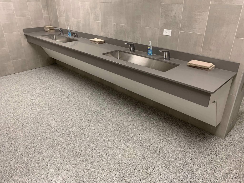 Commercial bathroom with laminate and silestone sinks