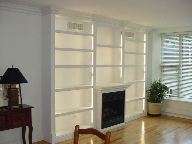 White fireplace bookcases with lights