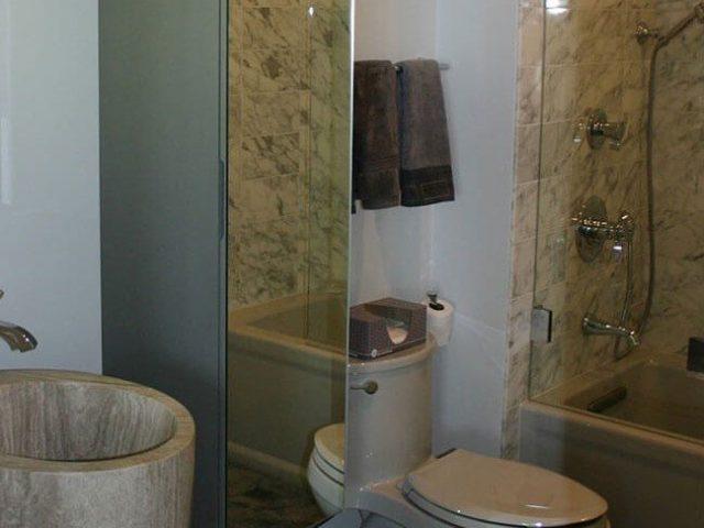 Linen cabinet with mirror door