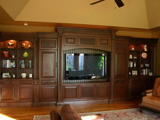 Custom media center with mahogany wood bookcases