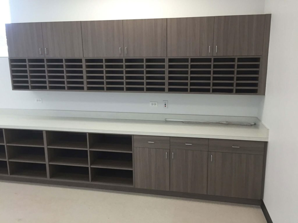 Mailroom with custom laminate cabinets