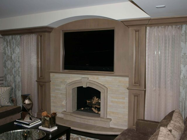 Maple wood and glazed fireplace surround cabinetry