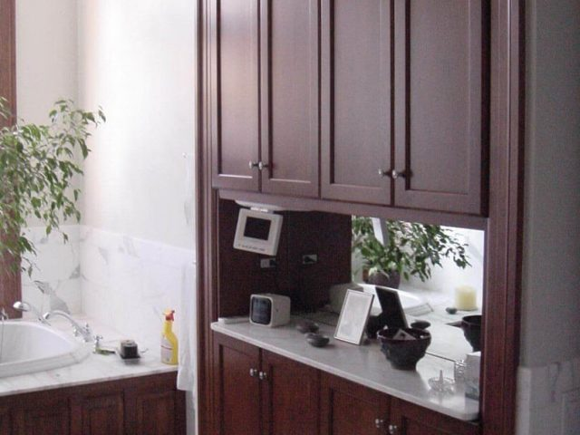 Maple wood makeup area cabinetry