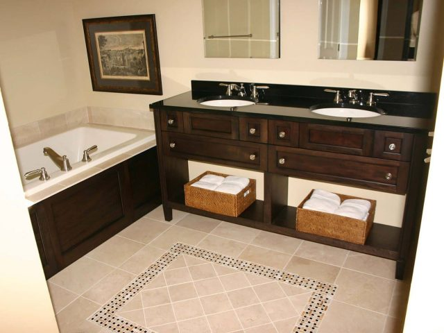 Maple wood vanity and bath panel cabinetry