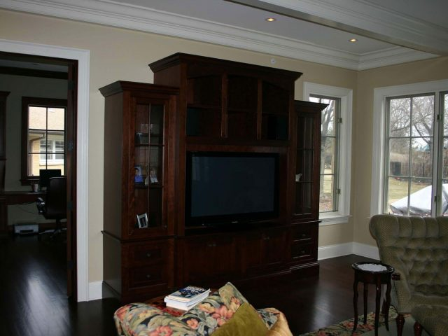 Media center cabinetry with glass shelves