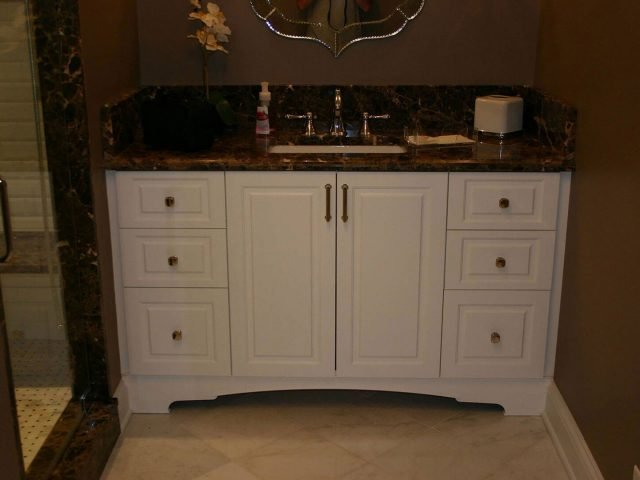 White vanity with raised panel fronts