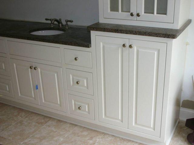 White vanity cabinets with raised panel doors