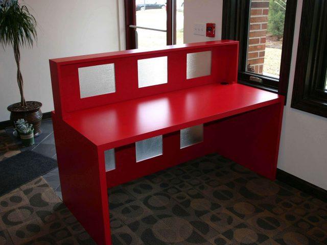 Red laminate reception desk