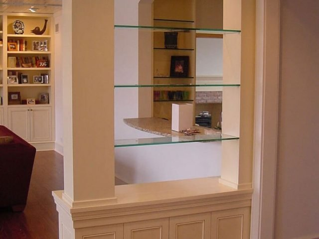 White room divider with glass shelves