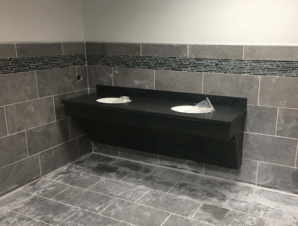 Solid surface and laminate restroom countertop