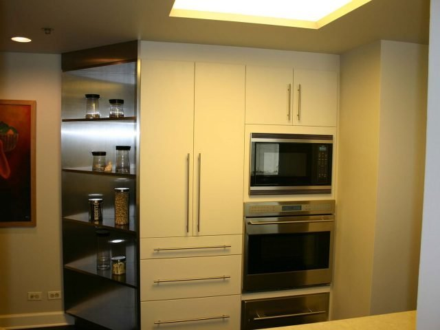 Stainless steel kitchen with painted cabinets