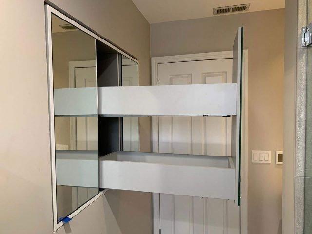 Three way mirror storage cabinets