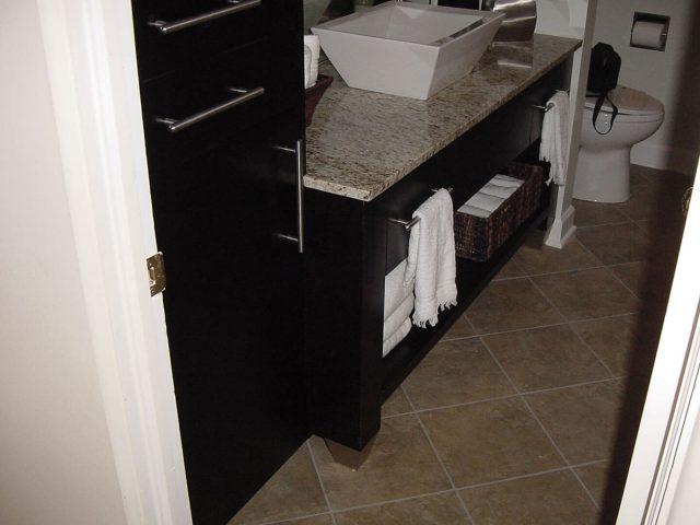 Dark vanity with vessel sink