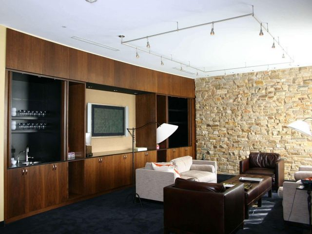 Commercial office with walnut wood cabinetry