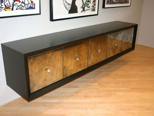 Walnut cabinets with glass fronts