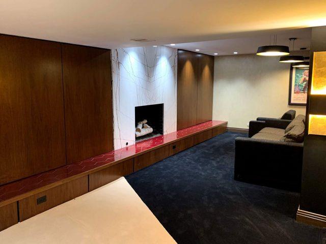 Walnut panel fireplace surround