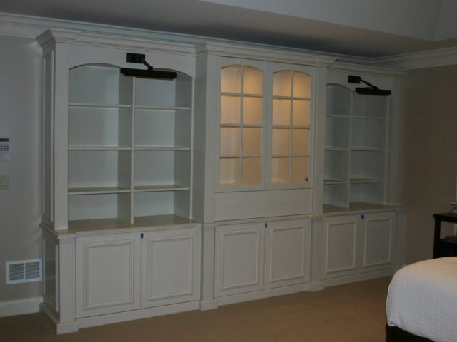 White bedroom bookcases with display lights