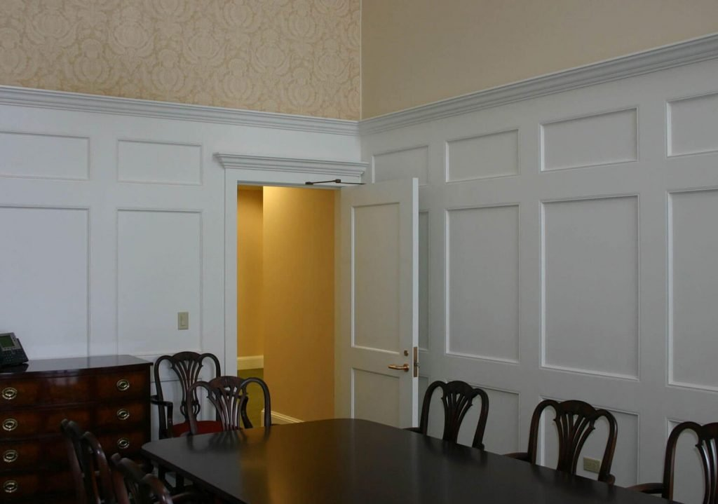 Board room with custom white millwork