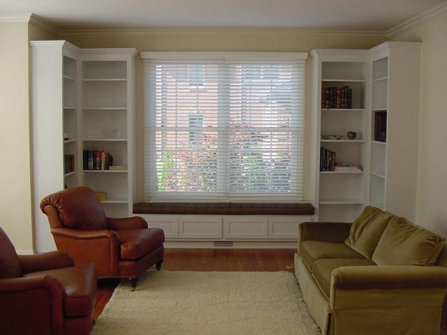 Window seat with white bookcases