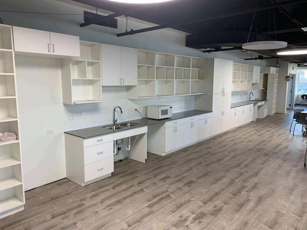 Breakroom with white cabinets