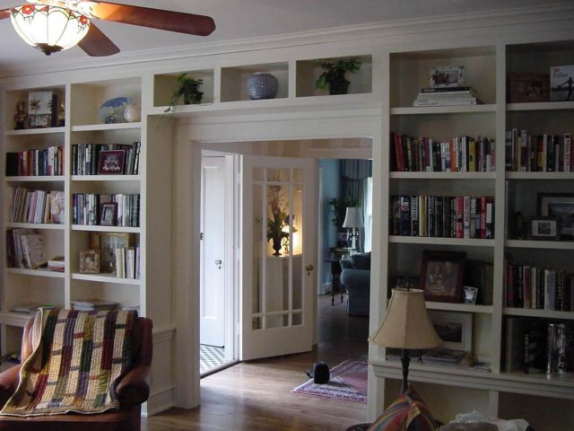 White built-in bookcases