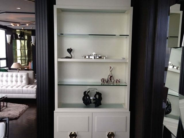 White display case with glass shelves