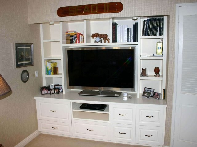 Entertainment center with white cabinetry and drawers