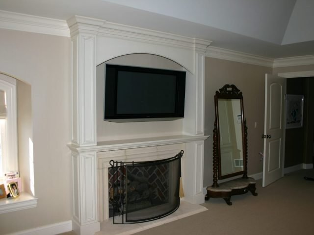 White fireplace surround and mantel