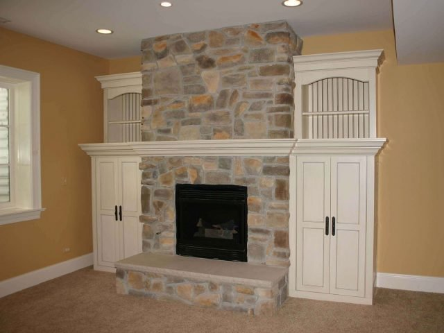 Fireplace surround with white cabinets