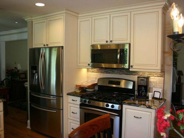 White kitchen cabinets with glaze finish